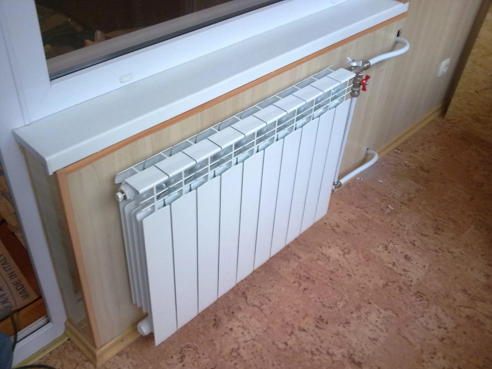 установка радиаторов отопления в квартире Рассел Терьер